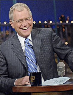 In this image originally provided by CBS, David Letterman appears on the &quot;Late Show with David Letterman,&quot; in this Oct. 8, 2007, file photo, in New York. Letterman wants to stick with CBS' &quot;Late Show&quot; through his contract -- and maybe longer -- as rival Jay Leno prepares to surrender the &quot;Tonight&quot; reins next year he said in an interview in Rolling Stone magazine. (AP Photo/John Paul Filo, CBS, File)