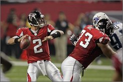 In this Aug. 22, 2008 file photo, Atlanta Falcons quarterback Matt Ryan (2) throws from the pocket during the first quarter of a preseason football game against the Tennessee Titans in Atlanta.  The Atlanta Falcons are taking a huge risk putting their No. 1 pick right on the field for a rebuilding team, especially behind a leaky offensive line.  (AP Photo/John Bazemore)