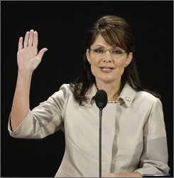 Republican vice presidential candidate Sarah Palin gestures during her speech at the Republican National Convention in St. Paul, Minn., Wednesday, Sept. 3, 2008.  (AP Photo/Ron Edmonds)