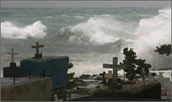 Strong waves caused by Tropical Storm Hanna break against the shore near a cemetery in Santo Domingo, Wednesday, Sept. 3, 2008. (AP Photo/Ramon Espinosa)