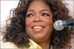 Oprah Winfrey speaks in Whitesboro, N.J. Satuday, Aug. 30, 2008. Winfrey is scheduled to be the keynote speaker Saturday at the annual festival in Whitesboro, a tiny, rural community founded in 1901 as a settlement for blacks leaving the South. (AP Photo/MJ Schear)