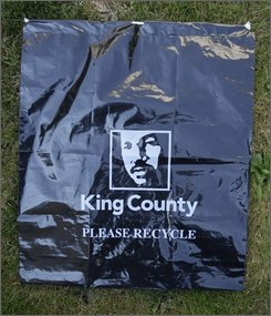 A roadside litter collection bag used by litter control programs in King County Wash., near Seattle, is shown Saturday, July 19, 2008. Officials are discontinuing the use of trash bags featuring the county's logo -- Martin Luther King Jr.'s face -- after deeming them innapropriate. The move opens a window into the tricky decisions the county has to make more than two years after becoming the first government to adopt King's face as an emblem. (AP Photo/Ted S. Warren)