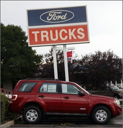 Unsold 2008 F-150 pickup trucks sit at a Ford dealership in the north Denver suburb of Northglenn, Colo., on Sunday, Aug. 24, 2008. Ford Motor Co. said Wednesday, Sept. 3, 2008, its U.S. sales tumbled in August on a steep drop in demand for pickup trucks and sport utility vehicles.(AP Photo/David Zalubowski)