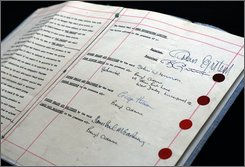 The Beatles' manager Brian Epstein's personal copy of the first fully signed contract with John Lennon, George Harrison and Paul McCartney, is seen during a presentation in London, Wednesday Sept. 3, 2008. The document will be auctioned on Sept. 4 and is estimated to fetch 500,000 pounds (US$89,500; 61,500euro).  (AP Photo/Lefteris Pitarakis)