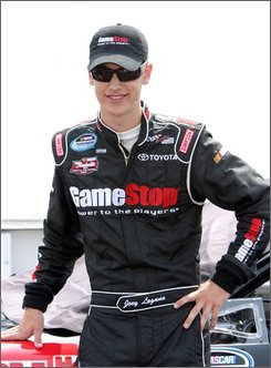 In this May 31, 2008 file photo, Joey Logano stands by his car before qualifying for the Heluva Good! 200 NASCAR Nationwide Series auto race at Dover International Speedway in Dover, Del. The 18-year-old will have to qualify for his first NASCAR Sprint Cup race this week at Richmond International Speedway.(AP Photo/Russ Hamilton, Jr)