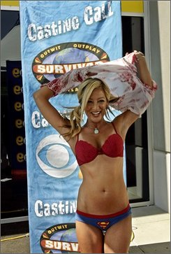 "Amber Horn, 30, strips to reveal her briefs and top, while auditioning for the CBS reality competition show ""Survivor,"" Thursday, June 19, 2008, in Costa Mesa, Calif. (AP Photo/Ric Francis)"