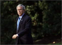 President Bush walks out of the Oval Office of the White House in Washington, Thursday, Sept. 4, 2008, toward the South Lawn before the boarding Marine One helicopter for a trip to Camp David. (AP Photo/Pablo Martinez Monsivais)