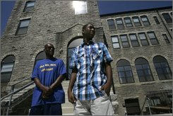 Richard Cherry Jr., right, 15, departs Boys' Latin of Philadelphia with his father, Richard Cherry Sr, in Philadelphia Tuesday July 15, 2008.  Boys' Latin of Philadelphia, one of the city's newer charter schools, aims to be an educational beacon in the financially and academically troubled district. But because it is single sex public school -- one of four in Philadelphia -- it faced huge opposition and almost didn't exist.  (AP Photo/Jacqueline Larma)