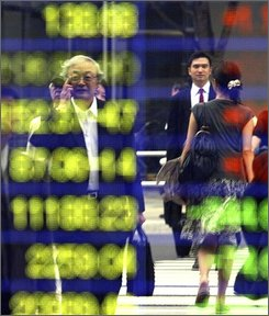 Pedestrians are reflected on an electronic stock indicator in Tokyo on Friday, Sept. 5, 2008. The benchmark Nikkei 225 index lost 319.05 to close the morning session at 12,238.61. (AP Photo/Koji Sasahara)