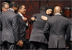 Janet Jackson, second from right, greets her brothers, from left, Jackie Jackson, Marlon Jackson, Tito Jackson and Randy Jackson of pop group The Jacksons before they received the BMI Icon award at the 8th Annual BMI Urban Awards in Beverly Hills, Calif., Thursday, Sept. 4, 2008. Looking on at far left is Del Bryant, President and CEO of BMI. (AP Photo/Chris Pizzello)