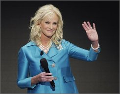 Cindy McCain, wife of Republican presidential candidate John McCain, waves during her speech at the Republican National Convention in St. Paul, Minn., Thursday, Sept. 4, 2008.  (AP Photo/Ron Edmonds)