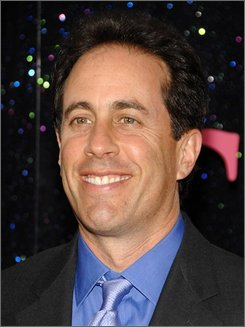 "In this May 27, 2008 file photo, comedian Jerry Seinfeld attends the premiere of ""Sex and the City"" at Radio City Music Hall  in New York. Seinfeld is the key pitchman in a highly anticipated $300 million advertising campaign that Microsoft launched Thursday night Sept. 4, 2008, in attempt to rebuff Apple's popular TV commercials, which have portrayed Microsoft and PCs as uncool.  (AP Photo/Evan Agostini, file)"