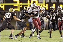 South Carolina tight end Jared Cook (84) is chased by Vanderbilt defenders Patrick Benoist (30), Reshard Langford (33), Chris Marve (13) and D.J. Moore (17) in the first quarter of an NCAA college football game in Nashville, Tenn., Thursday, Sept. 4, 2008. (AP Photo/Mark Humphrey)