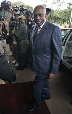 Angola's President Jose Eduardo dos Santos arrives at the Mulungushi International Conference Center in Lusaka, Zambia,  April 12, 2008. The opposition National Union for the Total Independence of Angola, which faces the longtime ruling party in elections Friday, has urged impoverished Angolans to vote for change. (AP Photo/Themba Hadebe)