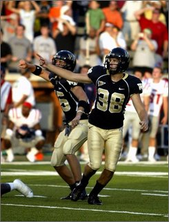 Wake Forest place-kicker Sam Swank (38) and holder Ryan McManus react as the ball clears the goalpost to score the game-winning field goal against Mississippi in an NCAA college football game Saturday, Sept. 6, 2008, at BB&T Field in Winston Salem, N.C. Wake Forest won 30-28. (AP Photo/Nell Redmond)