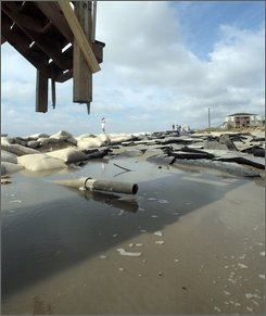A beach road washed away by Tropical Storm Hanna is seen at the east end of Ocean Isle Beach, N.C., Sept. 6, 2008. The storm made landfall overnight in the area causing erosion and flooding problems. (AP Photo/Dave Martin)
