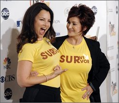 Fran Drescher, left, and Sharon Osbourne pose together before the Stand Up to Cancer benefit at the Kodak Theater in Los Angeles, Friday, Sept. 5, 2008. (AP Photo/Chris Pizzello)