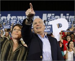 In this Sept. 5, 2008 file photo, Republican presidential candidate Sen., John McCain, R-AZ,and his vice presidential running mate, Alaska Gov., Sarah Palin acknowledge the cheers of supporters at the start of a campaign rally in Sterling Heights, MI. (AP Photo/Stephan Savoia)