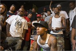Hip hop producer Jermaine DuPri, left, watches rapper The Game, upper right, defeat Bow Wow, center, 55-23 in an Xbox 360 Madden football video game showdown for charity in Los Angeles, Friday, Sept. 5, 2008. (AP Photo/Mark Avery)