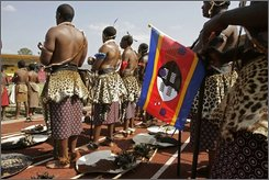 Swaziland men in traditional are seen, during the celebrations of Swaziland's King Mswati III birthday, on the outskirts of the city of  Mbabane, Swaziland, Saturday, Sept. 6, 2008. The Swazi king entered a stadium in an open-topped BMW to cheers and flag-waving Saturday, marking his 40th birthday and his country's 40th independence anniversary. (AP Photo/Schalk van Zuydam)