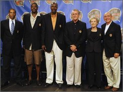 The 2008 Induction Class for the Basketball Hall of Fame, from left, Adrian Dantley, Patrick Ewing, Hakeem Olajuwon, Pat Riley, Cathy Rush and Dick Vitale pose at the Basketball Hall of Fame in Springfield, Mass., Friday, Sept. 5, 2008. (AP Photo/Nathan K. Martin)
