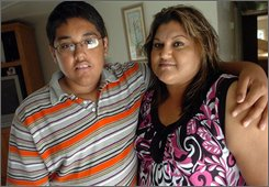 Irving Shaffino, 15, poses with his mother Guadalupe Shaffino in Shallowater, Texas, July 16, 2008.  Irving developed liver disease and had a liver transplant in July of 2007.  (AP Photo/Zach Long)