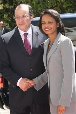 Morocco's foreign minister Taieb Fassi-Fihri, left, greets U.S. Secretary of State Condoleezza Rice in Rabat, Sunday, Sept. 7, 2008. Rice ended on Sunday a three-day visit to North Africa, including Libya, Tunisia, Algeria and Morocco, her first as Secretary of State in this region of increasing strategic importance in terms of oil resources, emigration and fighting terrorism. (AP Photo  / Abdeljalil Bounhar)