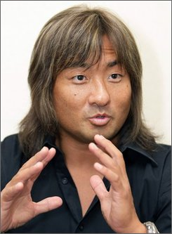 Japanese WWE wrestler Shoichi Funaki speaks for reporters before WWE SummerSlam Public Viewing event in Tokyo, Japan, Sunday, Sept. 7, 2008.  WWE's only Japanese superstar, 40-year-old Shoichi Funaki who goes by the ring name Funaki, acknowledged Japanese are just starting to enjoy WWE -- with all its boisterous exchanges and flamboyance, complete with heckling. (AP Photo/Shizuo Kambayashi)
