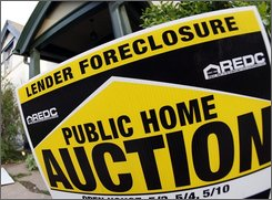 In this May 9, 2008 file photo, a foreclosure sign stands outside an existing home on the market in Denver. A record 9 percent of American homeowners with a mortgage were either behind on their payments or in foreclosure at the end of June, as damage from the housing crisis continues to mount, the Mortgage Bankers Association said Friday, Sept. 5, 2008. (AP Photo/David Zalubowski, file)