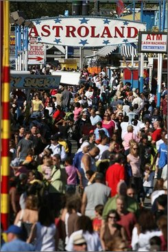 "Crowds pack into Astroland Park in Coney Island, New York, Sunday, Sept. 7, 2008.  The owner of Coney Island's landmark Astroland amusement park is calling it quits. Carol Albert says she has told employees the park will permanently close on Sunday. Albert's family has owned the Brooklyn amusement park for almost a half-century and says she is giving up on negotiating a two-year lease with Thor Equities, the developer that owns the seaside property. Thor spokesman Stefan Friedman said the firm was ""extremely disappointed"" that Albert had ""decided to give up on the future of Coney Island"" although her current lease was valid for several more months. (AP Photo/Seth Wenig)"