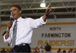 Democratic presidential candidate Sen. Barack Obama, D-Ill., speaks during a town hall meeting at North Farmington High School in Farmington Hills, Mich., Monday, Sept. 8, 2008.  (AP Photo/Chris Carlson)