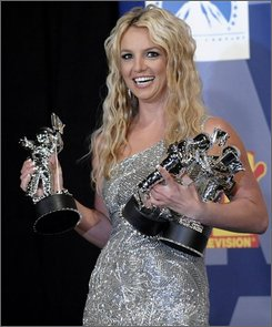 Britney Spears poses with her awards backstage at the 2008 MTV Video Music Awards held at Paramount Pictures Studio Lot on Sunday, Sept. 7, 2008, in Los Angeles. (AP Photo/Chris Pizzello)