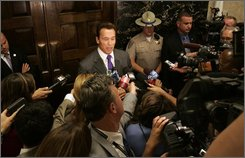 "Gov. Arnold Schwarzenegger told reporters that he would not be intimidated by the threat of a recall, outside his Capitol office in Sacramento, Calif., Monday, Sept. 8, 2008. The California Correctional Peace Officers Association announced Monday in a petition that they would begin take action to seek a recall of Schwarzenegger for ""catastrophic leadership failings and inept management"".  (AP Photo/Rich Pedroncelli)"