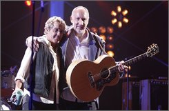 "In this July 12, 2008 file photo, musician Roger Daltrey, left, and Pete Townshend of ""The Who"" perform on VH1. Daltrey and Townshend will be honored at the Kennedy Center Honors, it was announced on Tuesday Sept. 9, 2008.  (Mark Davis/AP Images for VH1, File)"
