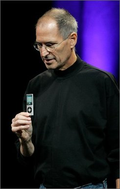 Apple CEO Steve Jobs holds up a new iPod Nano as he speaks at an Apple event in San Francisco, Tuesday, Sept. 9, 2008. (AP Photo/Jeff Chiu)