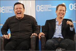"In this Sept. 6, 2008 file photo, actors Ricky Gervais, left, and Greg Kinnear participate in a news conference for ""Ghost Town"" during the Toronto International Film Festival in Toronto. (AP Photo/Evan Agostini, file)"