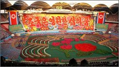 In this Korean Central News Agency photo released by Korea News Service in Tokyo on Tuesday, Sept. 9, 2008, a mass gymnastic display was performed at the May Day Stadium in Pyongyang, North Korea, Monday, Sept. 8, 2008 on the eve of the 60th anniversary of the country. (AP Photo/Korean Central News Agency via Korea News Service)