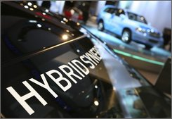 In this March 19, 2008 file photo, a Toyota Prius promotes hybrid technology at the New York International Auto Show. Auto industry allies hope to secure up to $50 billion in government loans this month that would pay to modernize plants and help struggling car makers build more fuel-efficient vehicles.    (AP Photo/Mark Lennihan, File)