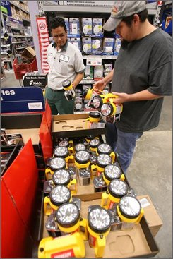Jose Sosa and Oscar Guerra check out flashlights at the Lowe?s store in Corpus Christi,Texas as they prepare for Hurricane Ike on Tuesday, Sept. 9, 2008.(AP PHOTO/Corpus Christi Caller-Times)