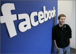 In this Feb. 5, 2007 file photo, Facebook CEO Mark Zuckerberg poses at his office in Palo Alto, Calif.  Zuckerberg is hoping to avoid a backlash as the popular online hangout prepares to impose its new look on its 100 million users, whether they like it or not.   (AP Photo/Paul Sakuma, file)