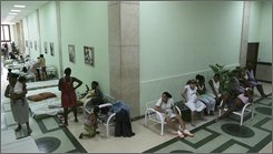 Evacuees from Hurricane Ike rest at a shelter in Havana, Tuesday, Sept. 9, 2008. Hurricane Ike roared ashore south of Cuba's densely populated capital of aging buildings Tuesday after tearing across the island nation, ravaging homes, killing at least four people and forcing 1.2 million to evacuate.  (AP Photo/Fernando Llano)