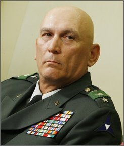 In this March 3, 2008, file photo, former commanding general of the Multinational Corps in Iraq, Army Lt. Gen. Ray Odierno, is seen in the Oval Office of the White House in Washington, Monday, March 3, 2008. Odierno is returning to Baghdad to command a slowly shrinking force in possibly the final phase of American combat action. Odierno, who finished a 15-month stint as the No. 2 commander in February, moves up a spot Sept. 16, 2008, succeeding Gen. David Petraeus as the overall commander of U.S. and allied forces in Iraq. (AP Photo/Charles Dharapak)
