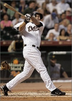 Houston Astros' Lance Berkman hits a three-run home run in the first inning of a baseball game against the Pittsburgh Pirates, Tuesday, Sept. 9, 2008 in Houston. (AP Photo/Pat Sullivan)