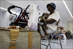 Josephine Williams and her grandson Robert Lee Williams wait to be evacuated at the   Oveal Williams Senior Center  in Corpus Christi, Texas, Wednesday, Sept. 10, 2008. The city began evacuation of people with special needs as Hurricane Ike moves closer to the Texas coast. (AP Photo/Eric Gay)