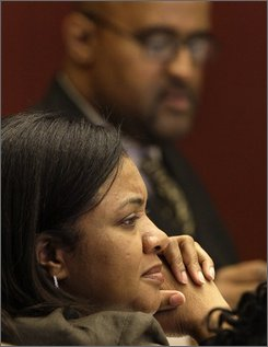 "Detroit City Council President Pro Tem Monica Conyers, foreground is shown  in a council meetin with Council President Ken Cockrel Jr., background, in Detroit, Tuesday, Sept. 9, 2008. Conyers, the wife of a one of the nation's most powerful congressmen, John Conyers, and one of the most volatile and unpredictable elected leaders in Detroit. She has been accused of threatening to shoot a mayoral staffer and publicly called the city council president, and now incoming mayor, ""Shrek."" In less than two weeks, she takes over as Detroit City Council president when Ken Cockrel Jr. moves up to the mayor's office, replacing the disgraced Kwame Kilpatrick.  (AP Photo/Paul Sancya)"