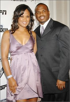 In this Oct. 15, 2007 file photo, Laila Ali and her husband Curtis Conway arrive at the Women's Sports Foundation's 28th Annual Salute to Women in Sports at the Waldorf-Astoria Hotel  in New York. (AP Photo/Evan Agostini, file)