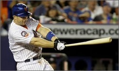New York Mets' David Wright hits an eighth-inning two-run home against the Washington Nationals in a baseball game at Shea Stadium in New York, Wednesday, Sept. 10, 2008. The Mets won 13-10. (AP Photo/Kathy Willens)
