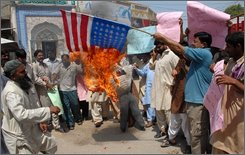 Pakistani protesters burn U.S. flag and an effigy of U.S. President George Bush to condemn alleged strikes in Pakistani tribal areas along Afghanistan border, Wednesday, Sept 10, 2008 in Multan, Pakistan. (AP Photo/Khalid Tanveer)