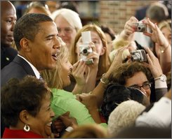 Democratic presidential candidate Sen. Barack Obama, D-Ill. greets supporters following a town hall meeting, Wednesday, Sept. 10, 2008, at Granby High School in Norfolk, Va.  (AP Photo/Chris Carlson)