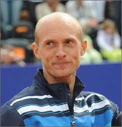 In this June 15, 2008 file photo, Russia's Nikolay Davydenko reacts after winning the final of the Orange Warsaw Open ATP tournament in Warsaw, Poland. Davydenko was cleared by the ATP on Friday Sept. 12, 2008 after a yearlong investigation into suspicious betting patterns on a match he lost to a low-ranked opponent. (AP Photo/Alik Keplicz, File)
